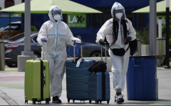 Travelers take extra precautions during the COVID-19 pandemic.